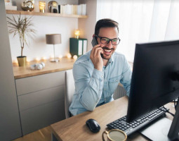 Man Smiling on cell phone, working on recruitment