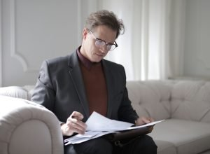 psychometric tests for leadership development: man reviewing documents